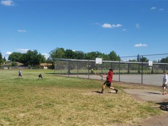 blast students playing softball