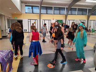 students participating in cake walk at carnival