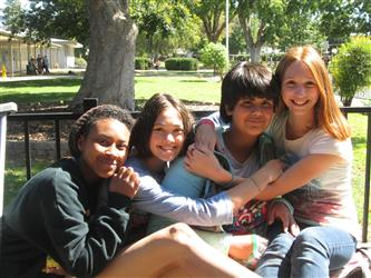 Group Photo of students on bench