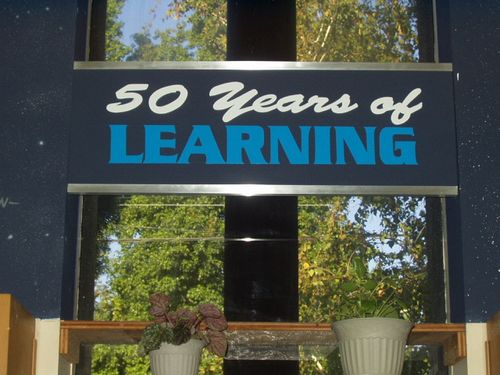 Sign in library reading 50 years of learning